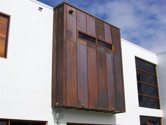 Metal cladding on house exterior